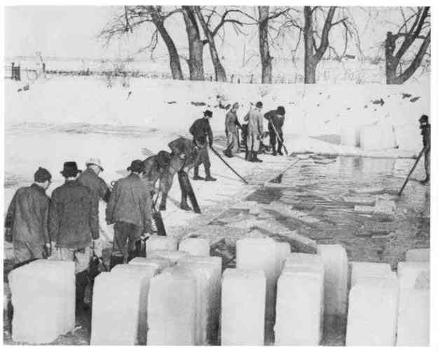 "Men cutting ice at West Lake Park, date unknown.  Photo 970553 of ""Wellington Family Album"" Collection, Herrick Memorial Library. Permission to display generously granted by the library."